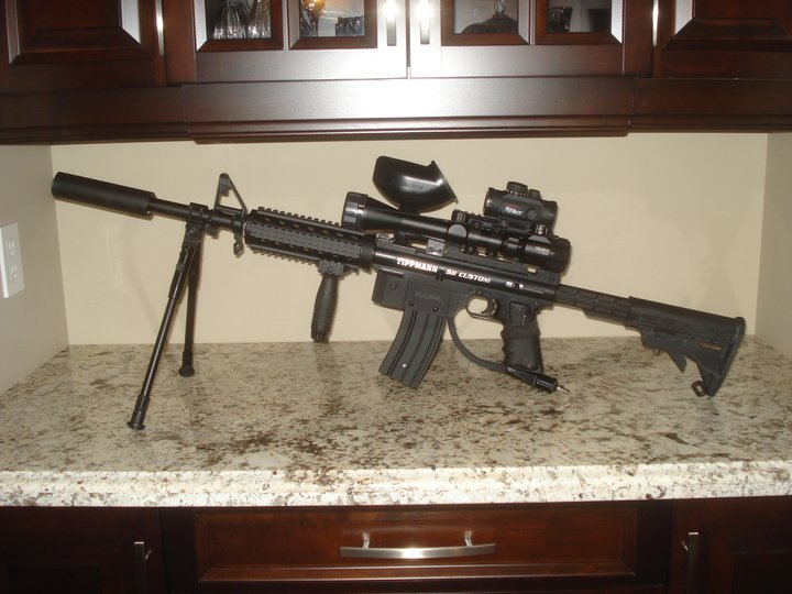 "Tippmann 98 Custom M4 Sniper Paintball Gun Modifications, M4 Magazine, 20"" Smart Parts Tactical Sniper Barrel, Bi-Pod, M4 Stock, Blue & Red Illuminated Scope, Tri-Picatinny Rail With Carry Handle - M4 Front Grip, Tasco Red Dot Scope, Black Paint Job, Paintball Marker Sniper Marksman"